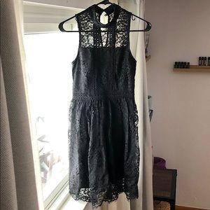 Black sleeveless lace midi dress with keyhole back